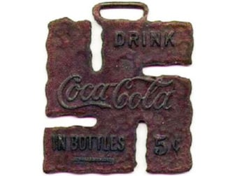 The swastika was used in early 20th century popular culture as a sign of good luck, such as on this Coca-Cola pendant. Photo courtesy of Steven Heller