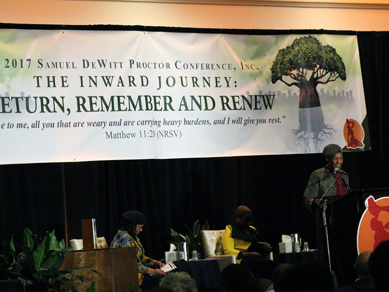 The Rev. Herbert Daughtry introduces his daughter, the Rev. Leah Daughtry, at the Samuel DeWitt Proctor Conference on Feb. 21, 2017. RNS photo by Adelle M. Banks