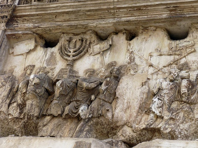 The depiction of Emperor Titus' Siege of Jerusalem in A.D. 70 includes a menorah being taken in the Arch of Titus in Rome. Photo courtesy of Creative Commons/Damian Entwistle
