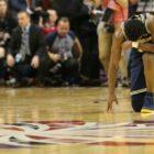 Michigan Wolverines guard Derrick Walton Jr. (10) kneels