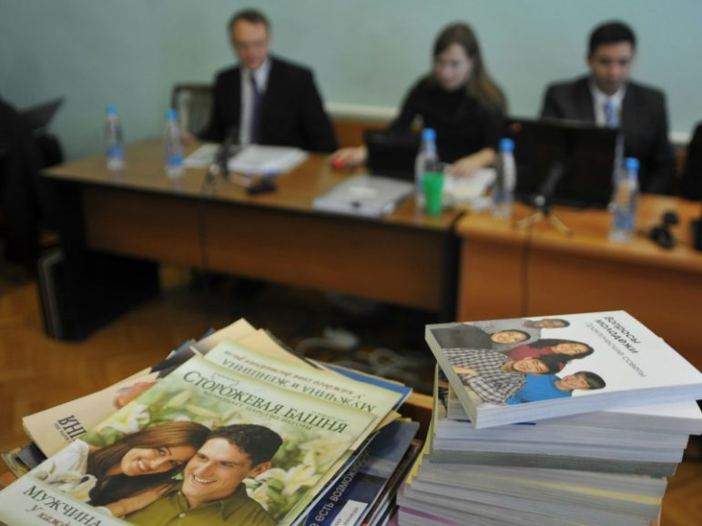 Stacks of booklets distributed by Alexander Kalistratov, left, the local leader of a Jehovah's Witnesses congregation, are seen during the court session Dec. 16, 2010, in the Siberian town of Gorno-Altaysk. Photo courtesy of Reuters/Alexandr Tyryshkin