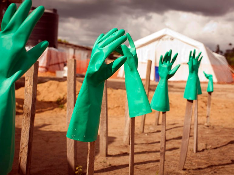 Gloves dry early in the Ebola epidemic, in Foya, Liberia. From Samaritan's Purse,