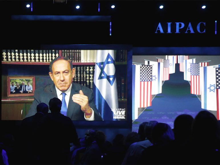 Israeli Prime Minister Benjamin Netanyahu speaks via a video link from Israel to the American Israel Public Affairs Committee (AIPAC) policy conference in Washington, D.C., on March 27, 2017.  Photo courtesy of Reuters/Joshua Roberts