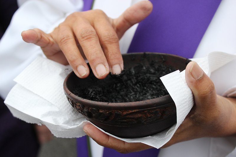 The Rev. Saroj Sangha of Glenmont United Methodist Church in Silver Spring, Md., holds a container of ashes on Ash Wednesday in her church's parking lot on March 1, 2017. RNS photo by Adelle M. Banks