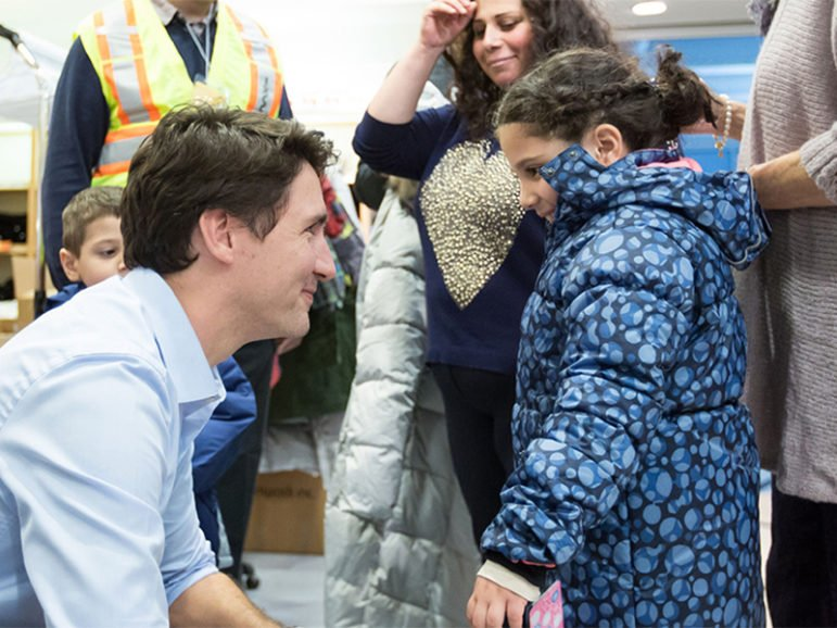 Canadian Prime Minister Justin Trudeau welcomes Syrian refugees at Pearson International Airport in December 2015. Photo courtesy of the Prime Minister's Office