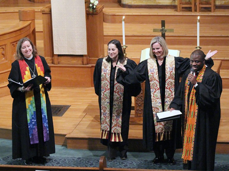 The Rev. Maria Swearingen, center left, and the Rev. Sally Sarratt, center right, are welcomed into membership at Calvary Baptist Church by other clergy members during a service on Feb. 26, 2017, in Washington, D.C. The Rev. Erica Lea, pastor in residence, is to the left, and the Rev. Elijah Zehyoue, pastoral resident, is to the right. RNS photo by Adelle M. Banks