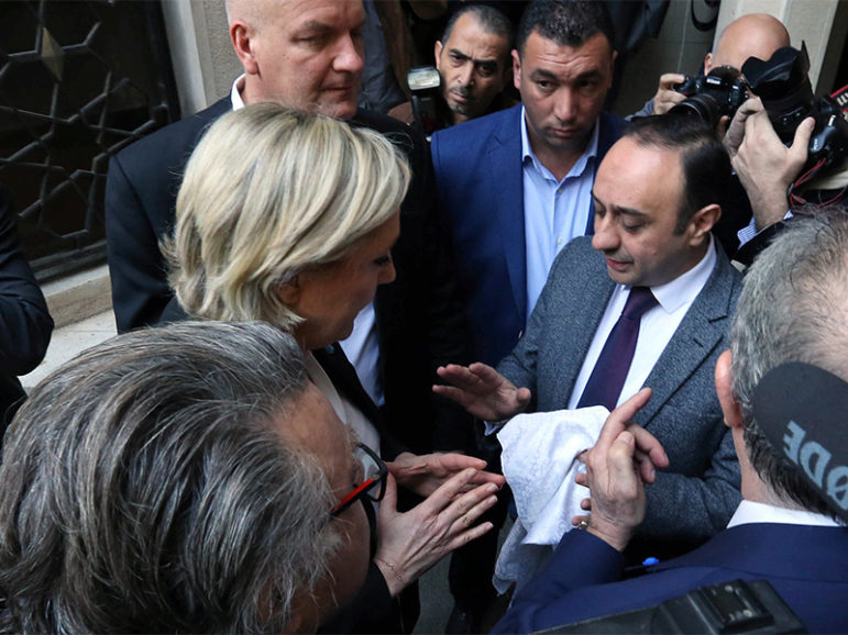 Marine Le Pen, French National Front (FN) political party leader and candidate in the French 2017 presidential election, refuses a headscarf for her meeting with Grand Mufti Sheikh Abdellatif Deriane in Beirut, Lebanon, on Feb. 21, 2017. Photo courtesy of Reuters/Aziz Taher