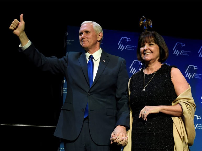 Vice President Mike Pence, left, and his wife, Karen Pence, acknowledge the audience before he speaks at the Republican Jewish Coalition's annual meeting in Las Vegas on Feb. 24, 2017. Photo courtesy of Reuters/David Becker