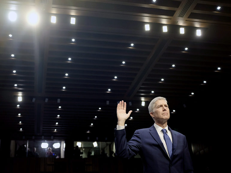 Supreme Court nominee Neil Gorsuch is sworn in to testify at his Senate Judiciary Committee confirmation hearing on Capitol Hill in Washington, D.C., on March 20, 2017. Photo courtesy of Reuters/James Lawler Duggan