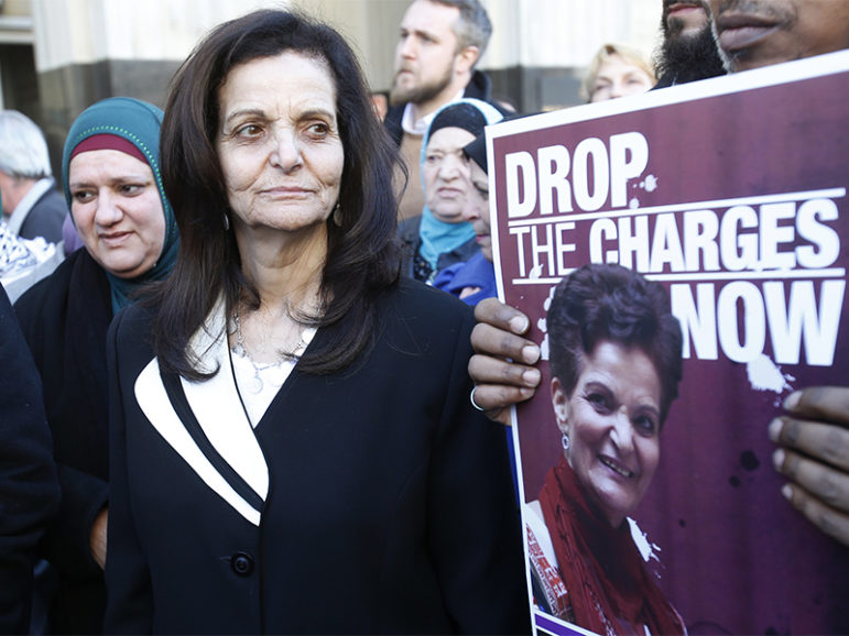 Palestinian activist Rasmea Odeh leaves the federal courthouse with supporters after her sentencing in Detroit on March 12, 2015. Photo courtesy of Reuters/Rebecca Cook *Editors: This photo may only be republished with RNS-WISE-OPED, originally transmitted on March 28, 2017.