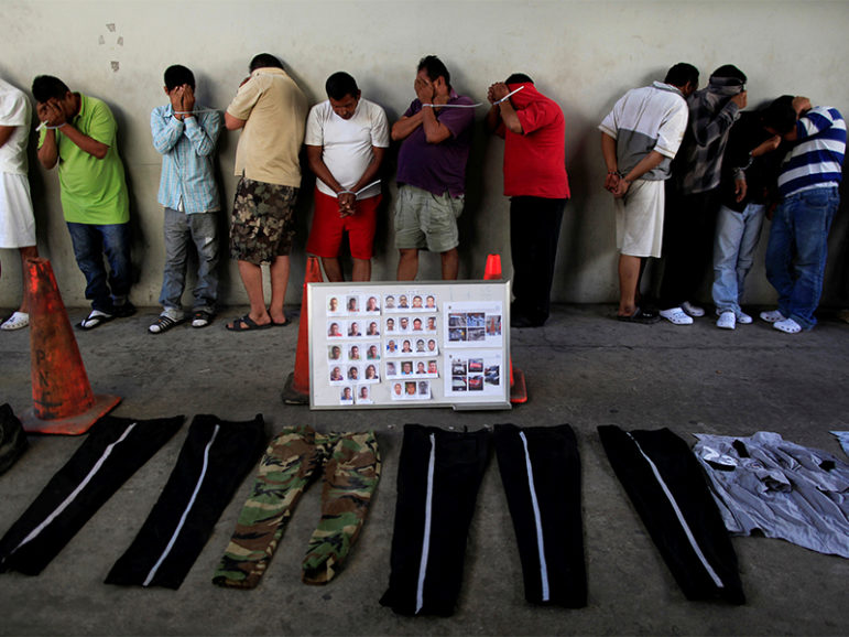 Suspected gang members are presented to the media after being detained by the police under the charges of homicide, extortion and bank robbery in San Salvador, El Salvador,  on Dec. 8, 2016. Photo courtesy of Reuters/Jose Cabezas