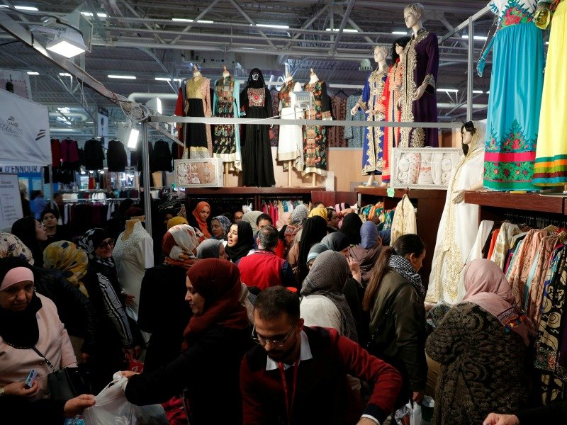 A stand displays women's clothes