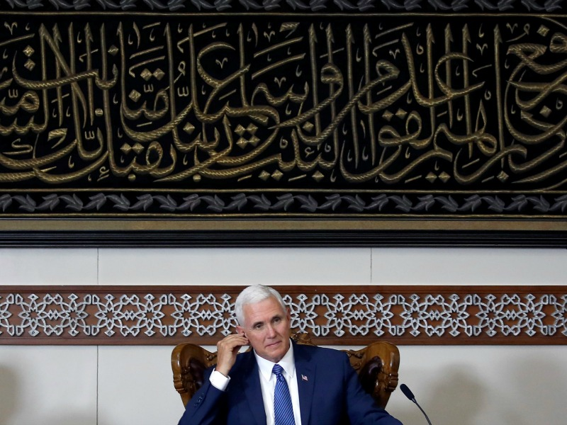Pence listens during a meeting with Indonesian Muslim community