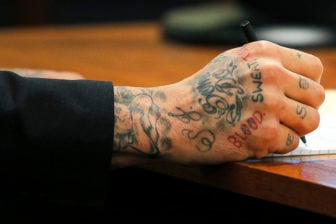 Why did aaron hernandez write john 3 16 on his forehead for Aaron hernandez neck tattoo meaning