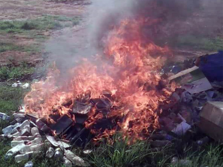 This image of bibles reportedly being burned at Pastor Aloysius Bugingo's church has been circulating on social media.  Image courtesy of Twitter