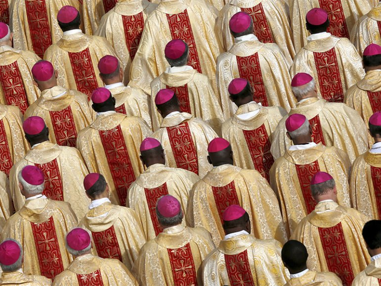 Bishops are seen in attendance as Pope Francis leads the Mass for a canonization in St. Peter's Square at the Vatican on Oct. 18, 2015. Photo courtesy of Reuters/Alessandro Bianchi