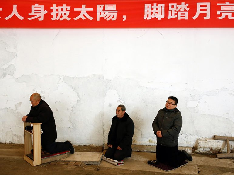 Men attend Sunday service at a makeshift, tin-roofed church in Youtong village, China, on Dec. 11, 2016. Photo courtesy of Reuters/Thomas Peter