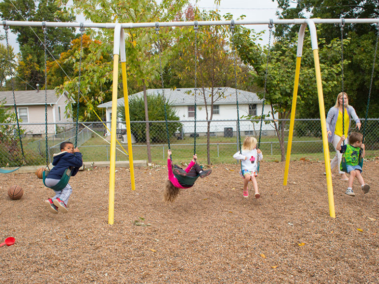 Children play on a gravel playground at Trinity Lutheran Church's Child Learning Center in Columbia, Mo., on Oct. 18, 2016. RNS photo by Sally Morrow