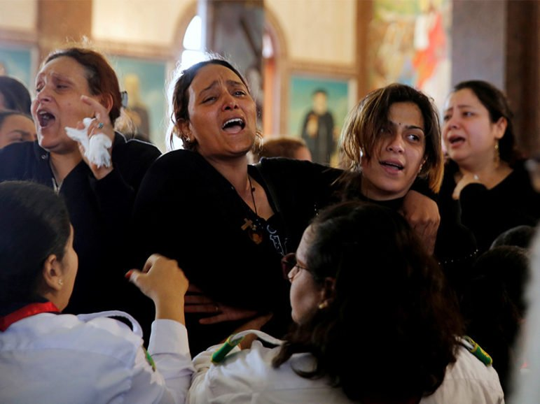Relatives react as they mourn for the victims of the Palm Sunday bombings during their funeral at the Monastery of St. Mina (Deir Mar Mina) in Alexandria, Egypt, on April 10, 2017. Photo courtesy of Reuters/Amr Abdallah Dalsh