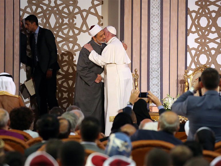 Pope Francis, right, embraces Al-Azhar's Grand Imam Ahmed al-Tayeb during a meeting in Cairo, Egypt, on April 28, 2017.  Photo courtesy of Reuters/Alessandro Bianchi