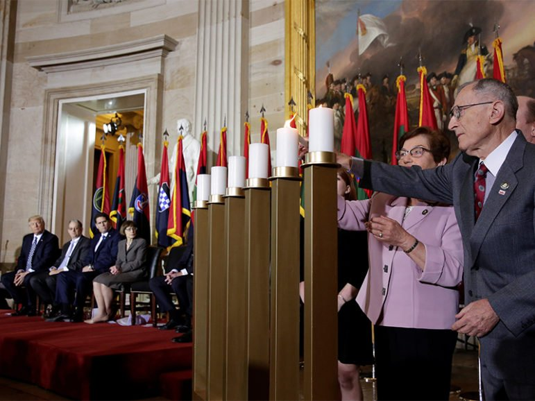 President Trump, far left, looks on as Holocaust survivors light candles during the U.S. Holocaust Memorial Museum's