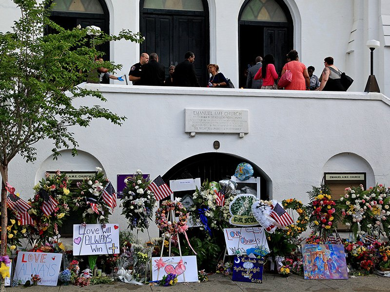 A memorial to shooting victims is set up in front of Mother Emanuel African Methodist Episcopal Church in Charleston, S.C., on June 28, 2015. Photo courtesy of Creative Commons/Matt Drobnik