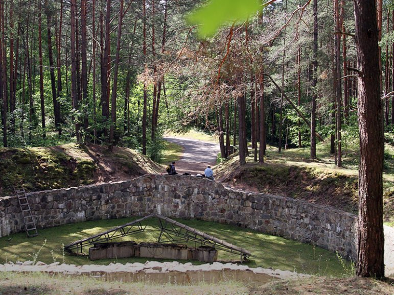 The infamous Burning Pit, the location in the Ponary Forest near Vilnius, Lithuania, used by the Nazi's to burn the remains of their Jewish victims in order to rid themselves of all evidence.  Photo courtesy of Ezra Wolfinger for WGBH