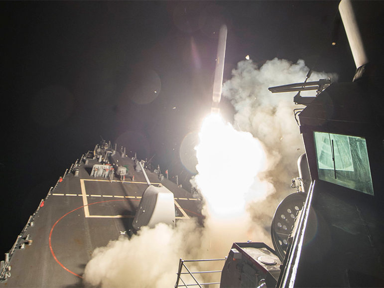 U.S. Navy guided-missile destroyer USS Ross (DDG 71) fires a tomahawk land attack missile from the Mediterranean Sea on April 7, 2017. The U.S. Defense Department said it was a part of cruise missile strikes against Syria.  Photo courtesy of Robert S. Price/U.S. Navy handout via Reuters
