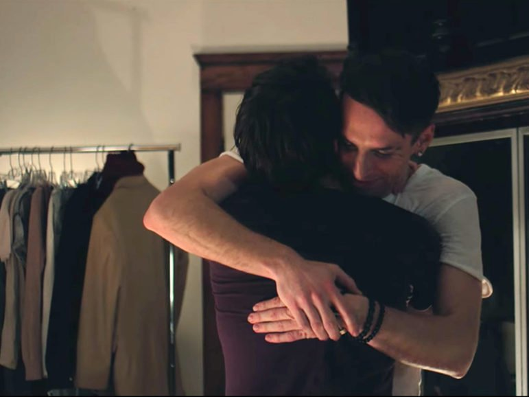 """Artist Trey Pearson hugs a man in a final scene from the music video of his new single, """"Silver Horizon."""" Screenshot from YouTube"""