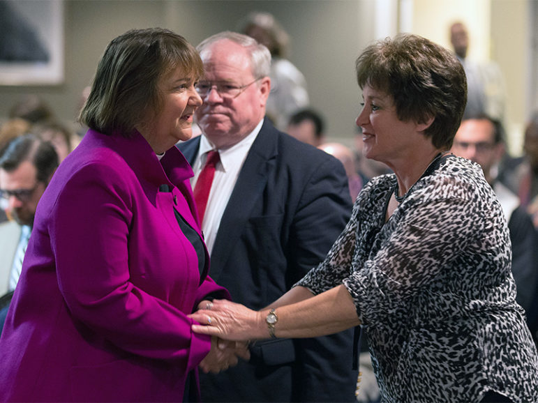 Bishop Karen Oliveto, left, greets Dixie Brewster ahead of the opening of oral arguments before the United Methodist Judicial Council meeting on April 25, 2017, in Newark, N.J. Brewster is a petitioner questioning whether a gay pastor can serve as a bishop in the United Methodist Church. At rear is the Rev. Keith Boyette, representing Brewster before the council.  Photo courtesy of UMNS/Mike DuBose