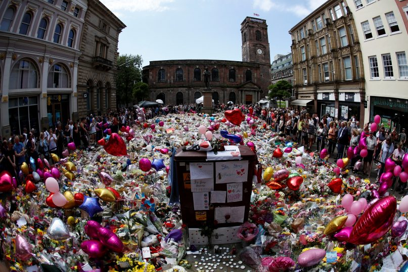 People look at floral tributes for the victims of the Manchester Arena attack, in St. Ann's Square in central Manchester, Britain, on May 27, 2017. Reuters/Stefan Wermuth