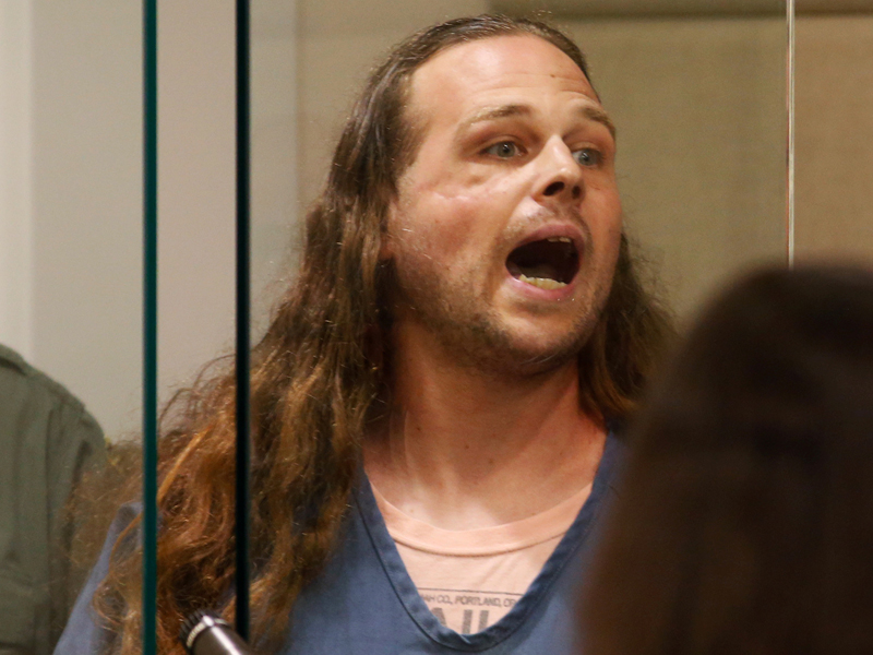 A convicted felon, Jeremy Christian, 35, accused of fatally stabbings two Good Samaritans who tried to stop Christian from harassing a pair of women who appeared to be Muslim, shouts during an appearance in Multnomah County Circuit Court in Portland, Ore., May 30, 2017. Photo courtesy REUTERS/Beth Nakamura