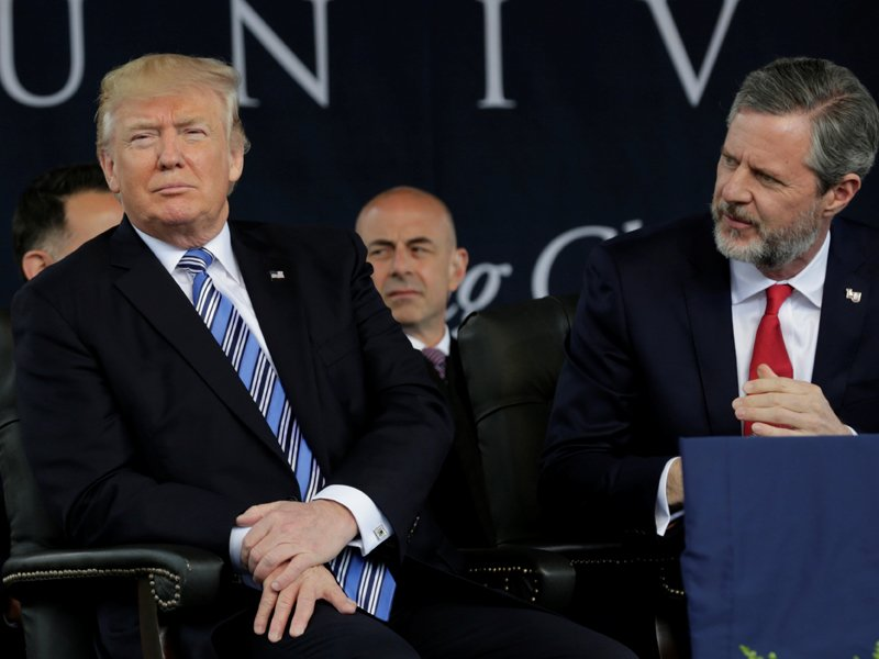 President Trump sits before delivering keynote address at Liberty University's commencement in Lynchburg, Va., on May 13, 2017. Seated next to him is Liberty University President Jerry Falwell Jr. Photo courtesy Reuters/Yuri Gripas