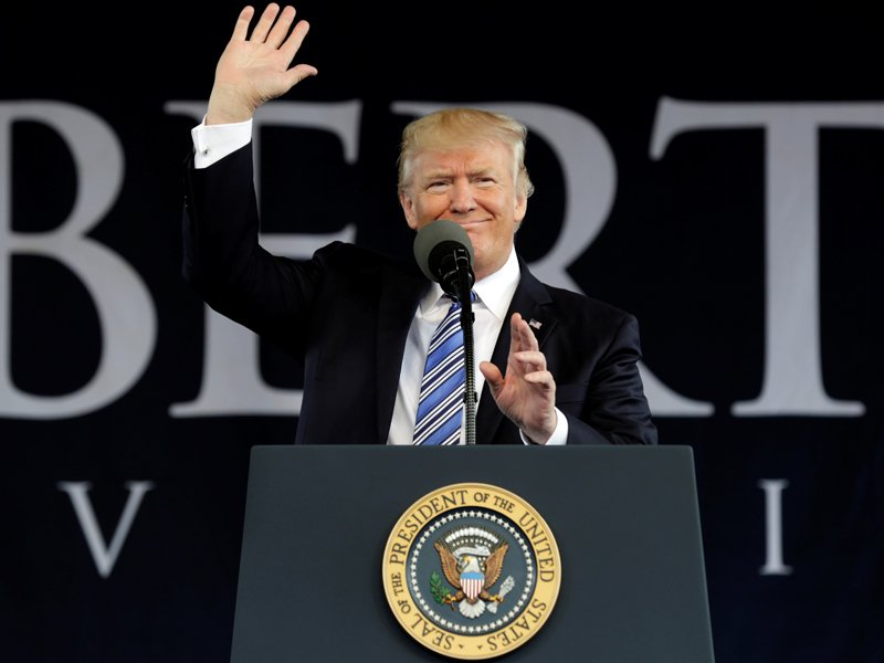 President Trump waves before delivering keynote address at Liberty University's commencement in Lynchburg, Va., on May 13, 2017. Photo courtesy REUTERS/Yuri Gripas