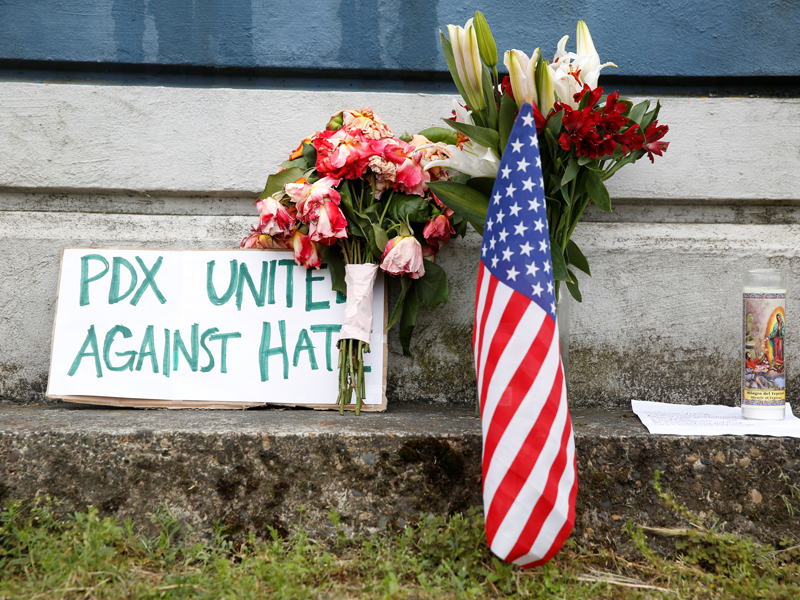 A sign rests against a wall May 29, 2017, in Portland, Ore., at a makeshift memorial for two men killed on a commuter train while trying to stop another man from harassing two young women who appeared to be Muslim. Photo courtesy of Reuters/Terray Sylvester