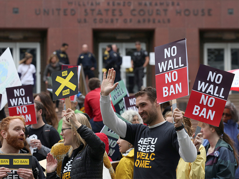 People protest President Trump's second travel ban outside of the U.S. Court of Appeals in Seattle on May 15, 2017.  Photo courtesy of Reuters/David Ryder
