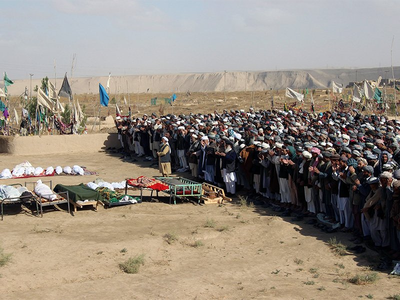 Afghans perform prayers at the funeral for the victims killed by an airstrike called in to protect Afghan and U.S. forces during a raid on suspected Taliban militants, in Kunduz, Afghanistan, on Nov. 4, 2016. Photo courtesy of Reuters/Nasir Wakif
