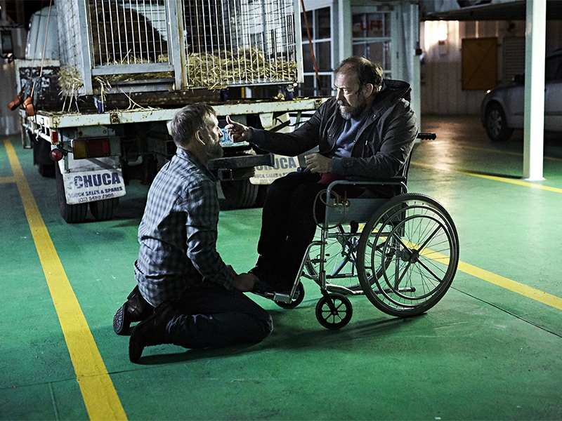 """Christopher Eccleston as Matt Jamison, left, keels during a scene from """"The Leftovers."""" Photo courtesy of Ben King/HBO"""