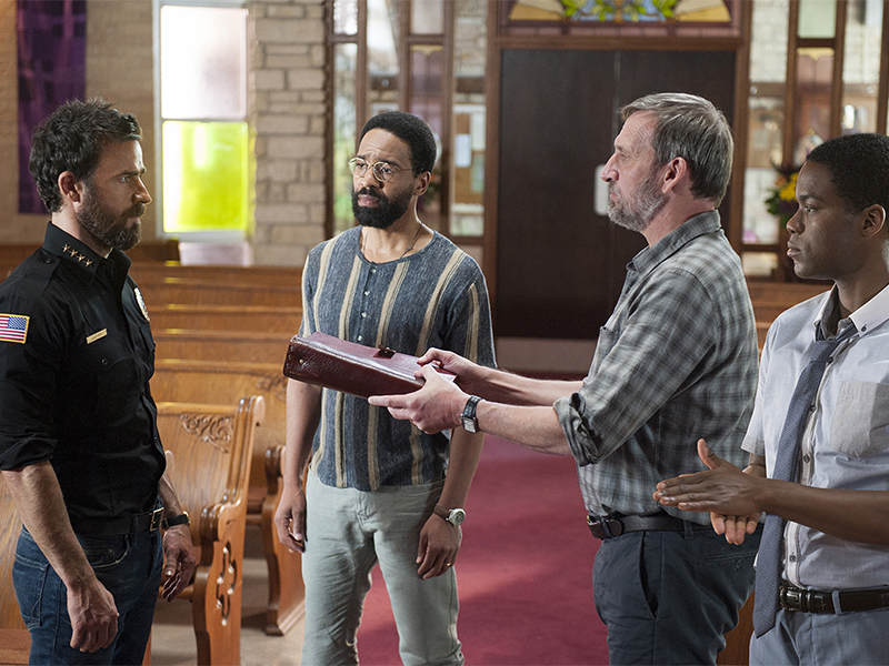 """Justin Theroux as Kevin Garvey, from left, Kevin Carroll as John Murphy, Christopher Eccleston as Matt Jamison, and Jovan Adepo as Michael Murphy in a scene from """"The Leftovers."""" Photo courtesy of Van Redin/HBO"""
