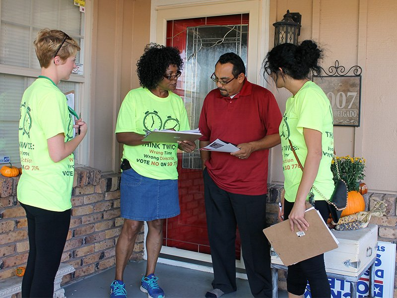 Connie Johnson, center, chairwoman of the Oklahoma Coalition to Abolish the Death Penalty, campaigns against the death penalty in an Oklahoma City neighborhood on Oct. 16, 2016. RNS photo by Bobby Ross Jr.