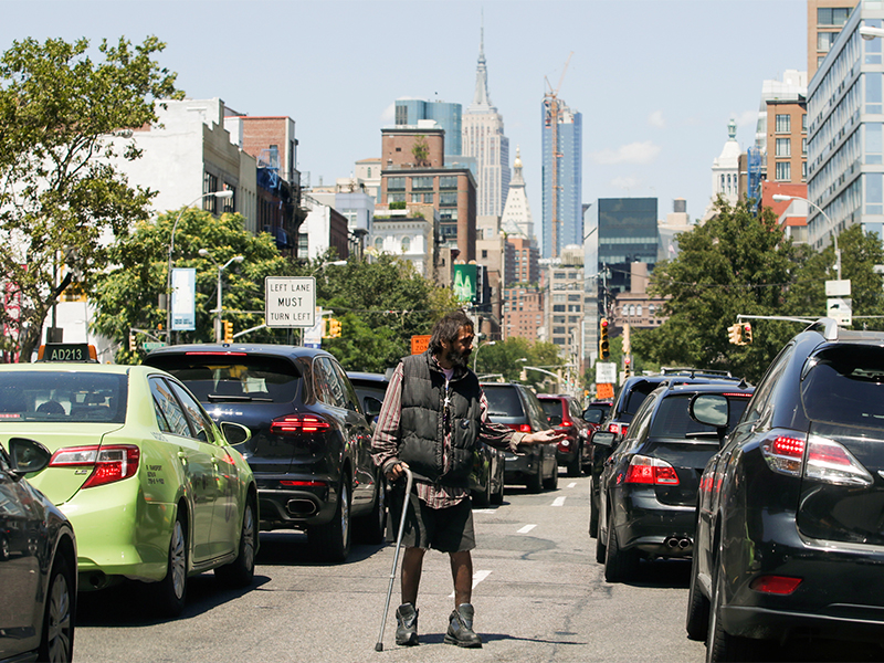 A man begs for money on a street during a heat wave in Brooklyn, N.Y., on July 23, 2016. Photo courtesy of Reuters/Eduardo Munoz