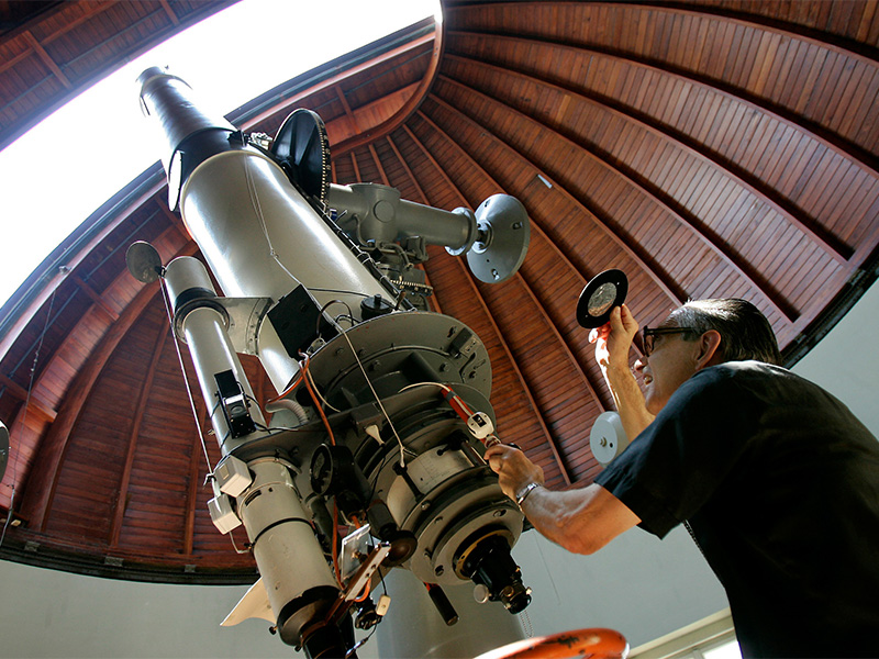 The Rev. Emmanuel Carreira operates the telescope at the Vatican Observatory in Castel Gandolfo, south of Rome, on June 23, 2005. The Vatican Observatory, one of the world's oldest astronomical institutes, selects young, promising scholars for courses at the papal summer palace. Photo courtesy of Reuters/Tony Gentile