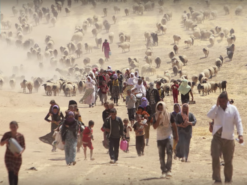 A still of refugees in