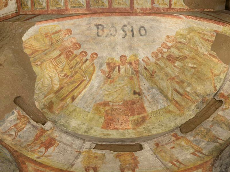 The catacombs of Domitilla were uncovered by 16th century archeologist, Antonio Bosio, who scribbled his name above wall frescoes.  The frescoes depict biblical scenes and characters from the Old and New Testament. Photo courtesy of the Pontifical Commission for Sacred Archeology