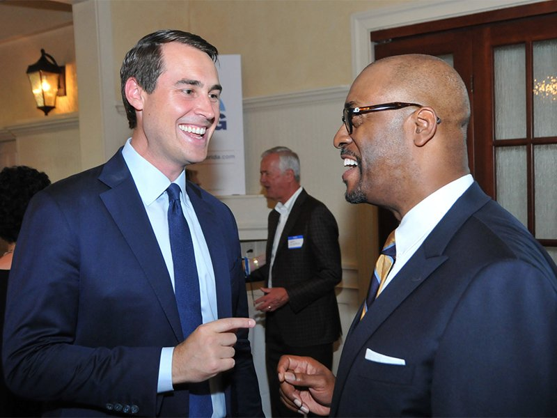 Chris King, left, and Bishop Allen T.D. Wiggins interact during a fundraiser in Orlando, Fla., on May 10, 2017.  Photo courtesy of Sarah M. Brown