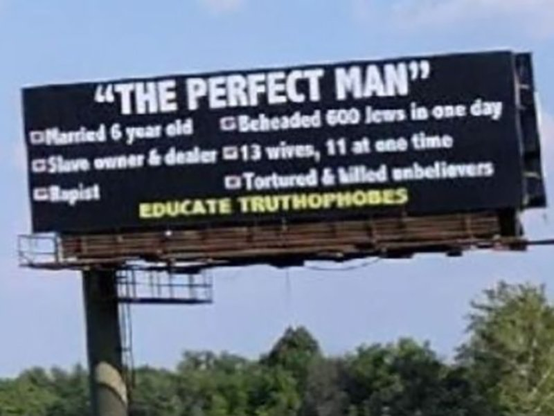 A billboard insulting  the Prophet Muhammad is seen from the southbound lanes of Interstate 465 on Indianapolis' east side.  Photo courtesy of Rima Shahid