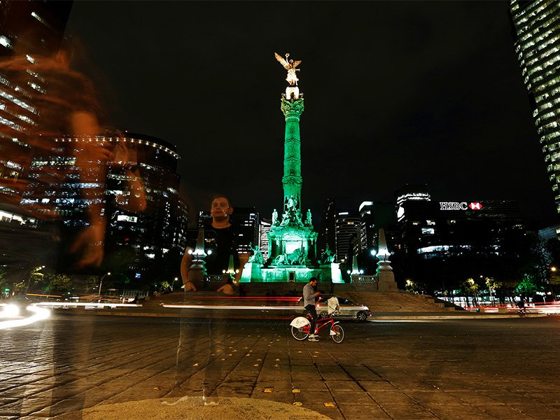 Green lights are projected at the Angel of Independence monument in Mexico City in support in the Paris climate agreement after U.S. President Trump announced his decision June 1, 2017, that the United States will withdraw from the accord. Photo courtesy of Reuters/Carlos Jasso