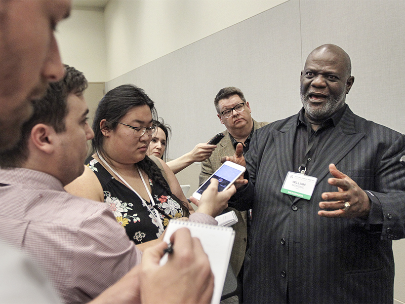 The Rev. Dwight McKissic, pastor of Cornerstone Baptist Church in Arlington, Texas, speaks with reporters after a resolution similar to one he submitted June 13 on racism was unanimously approved June 14, 2017. Messengers adopted a resolution
