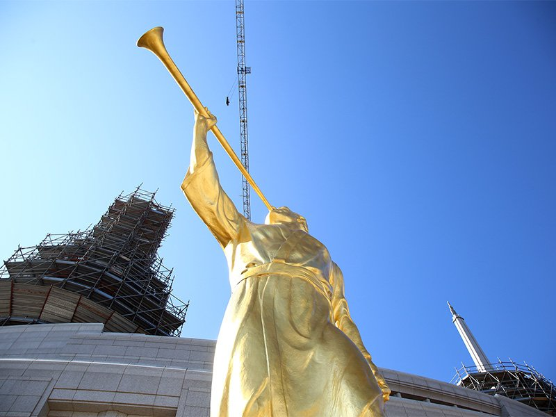 A gold-leaf statue depicting the ancient Mormon prophet, Moroni, is prepared for placement on one of the spires of the new Mormon temple in Rome on March 25, 2017.  Photo courtesy of Claudio Falanga/Intellectual Reserve Inc.