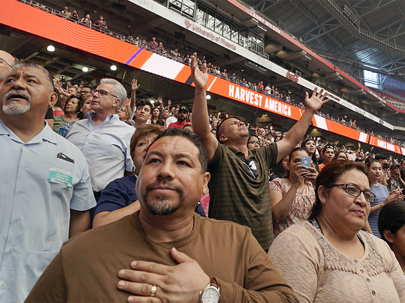 During worship at Harvest America on June 11, 2017, at the University of Phoenix Stadium in Glendale, Ariz., thousands of attendees heard the gospel message by California Pastor Greg Laurie of Harvest Christian Fellowship in Riverside, Calif. Photo courtesy of Baptist Press/Adam Covington